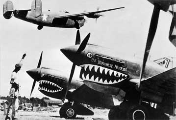 P-40 Flying Tigers wait at an airfield in China during WWII